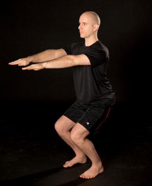 brian-paquette-chair-pose-chagrin-yoga.jpg